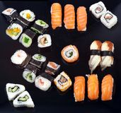 Sushi tray. (on the black plate Royalty Free Stock Photo