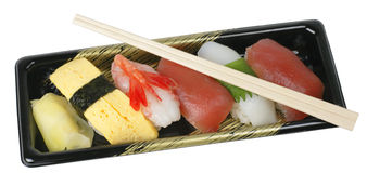 Sushi tray and chopsticks-clipping path Royalty Free Stock Photography