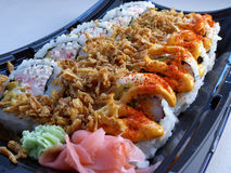 Sushi tray closeup. Close up on a sushi tray with different rolls and toppings Royalty Free Stock Photo