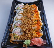 Sushi tray closeup. Close up on a sushi tray with different rolls and toppings Stock Photography