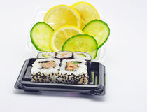 Sushi on a tray with lemon and cucumber Stock Photos
