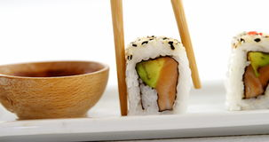 Sushi on tray with sauce. And chopsticks stock video footage
