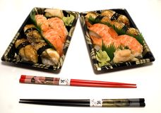 Sushi Trays and Chopsticks. Colorful Sushi Trays with shrimp and eel with Chopsticks royalty free stock photos