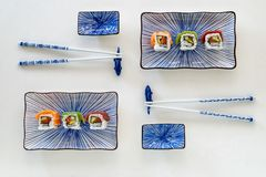 Sushi trio on blue cermic plates stock photos