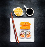 Sushi with Tsukemono and Soy Sauce on White Plate Stock Photos