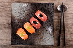 Sushi : Tuna and salmon sushi set with chopsticks Stock Photography