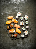 Sushi with tuna, shrimp, salmon and rolls. Stock Photos