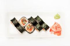 Sushi with tuna wrapped in nori on a white plate Royalty Free Stock Photo