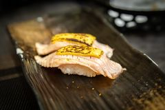 Sushi, a typical Japanese food. Prepared with a base of rice and various fish. In this case it is Tuna just scalded with a cheese hat Royalty Free Stock Photography