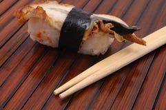Sushi und Rollen Lizenzfreie Stockfotos