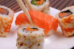Sushi und Rollen Stockfotografie