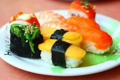 Sushi und Rollen Lizenzfreie Stockfotografie
