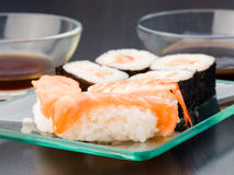 Sushi with various bowl of sauce in  tray. Sushi with various bowl of sauce in glass tray Stock Images