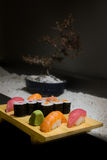 Sushi. Various sushi rolls on wooden plate Stock Image