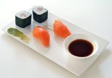 Sushi Wasabi Hosomaki Nigiri and Soy Sauce. On white plate Royalty Free Stock Photos