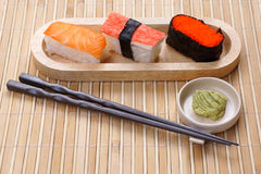 Sushi with wasabi. Set of sushi with wasabi on the wood plate Royalty Free Stock Image
