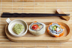 Sushi with wasabi. Set of sushi with wasabi on the wood plate Royalty Free Stock Images