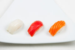 Sushi on white. Three sushi on white plate Royalty Free Stock Photos