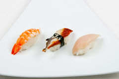 Sushi on white. Three sushi on white plate Stock Photo