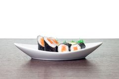 Sushi in white boat plate. Maki sushi in dish with copyspace Royalty Free Stock Image