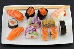 Sushi on white dish on dark Stock Images