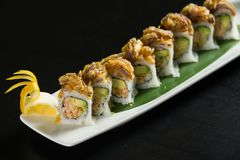 Sushi on a white plate. Close up of sushi on a white plate stock photos