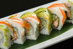 Sushi on a white plate. Close up of sushi on a white plate royalty free stock image