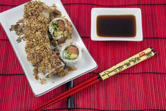 Sushi on the white plate with plate of soy sauce and red chopsticks Stock Photography