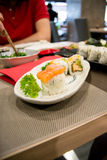 Sushi on a white plate in a restaurant Stock Photo