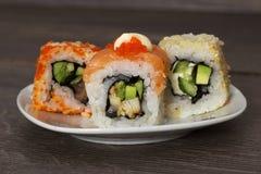 Sushi on wooden background Royalty Free Stock Photo