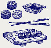 Sushi on a wooden board with chopsticks Stock Images