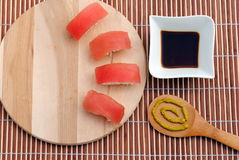 Sushi on wooden board with soy sauce and wasabi. Bamboo background Royalty Free Stock Photos