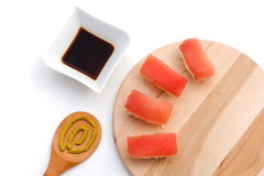 Sushi on wooden board with soy sauce and wasabi. Bamboo background Stock Photo