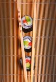 Sushi and wooden chopsticks Stock Images