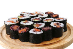 Sushi on wooden plate Stock Photo