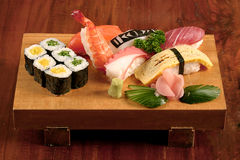 Sushi on wooden plate Royalty Free Stock Photo