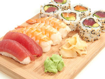 Sushi on a wooden plate Stock Photos