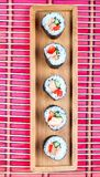 Sushi on a wooden platter and bamboo mat Stock Photo
