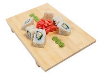 Sushi on wooden stand Stock Images