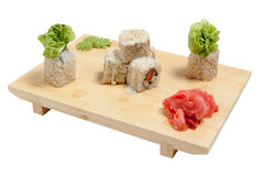 Sushi on wooden stand. Isolated on white background Stock Photography