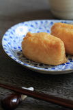 Sushi wrapped in fried bean curd. Japanese sushi rice wrapped in fried bean curd Stock Image