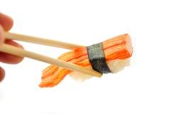 Sushi y palillos Imagen de archivo libre de regalías