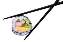 Sushi y palillos aislados en blanco Imágenes de archivo libres de regalías