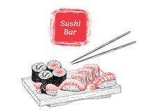 Sushi y rollos del ejemplo a mano Fotos de archivo