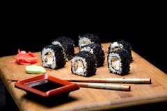 Sushi zuko maki with shrimp, cheese, cucumber and black masago caviar. Royalty Free Stock Images