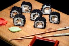 Sushi zuko maki with shrimp, cheese, cucumber and black masago caviar. Stock Photos