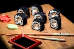 Sushi zuko maki with shrimp, cheese, cucumber and black masago caviar. Royalty Free Stock Photos
