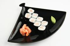 Sushirolle mit Stange Lizenzfreie Stockfotografie