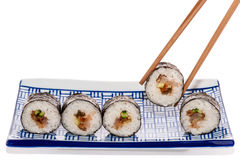 Sushirolls and chopsticks Royalty Free Stock Images