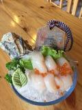 Sushiuppsättningen många fiskar sashimimarki Royaltyfri Fotografi